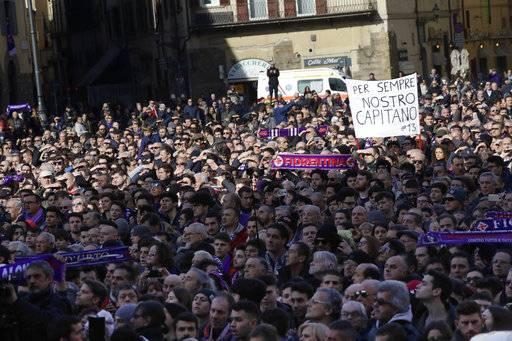 Fiorentina fans attend the funeral ceremony of Italian player Davide Astori in Florence, Italy, Thursday, March 8, 2018. The 31-year-old Astori was found dead in his hotel room on Sunday after a suspected cardiac arrest before his team was set to play an Italian league match at Udinese.