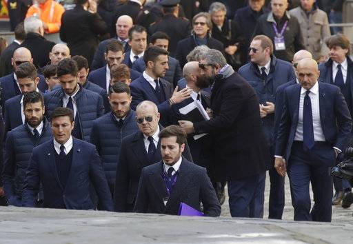 Inter of Milan players and their coach Luciano Spalletti, right, arrive for the funeral ceremony of Italian player Davide Astori in Florence, Italy, Thursday, March 8, 2018. The 31-year-old Astori was found dead in his hotel room on Sunday after a suspected cardiac arrest before his team was set to play an Italian league match at Udinese.