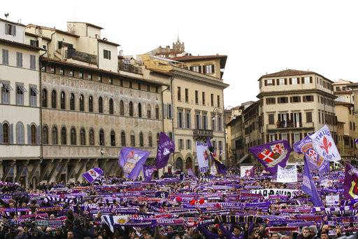 Fiorentina fans wait outside the church during the funeral ceremony of Italian player Davide Astori in Florence, Italy, Thursday, March 8, 2018. The 31-year-old Astori was found dead in his hotel room on Sunday after a suspected cardiac arrest before his team was set to play an Italian league match at Udinese.