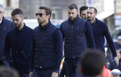 Juventus players arrive for the funeral ceremony of Italian player Davide Astori in Florence, Italy, Thursday, March 8, 2018. The 31-year-old Astori was found dead in his hotel room on Sunday after a suspected cardiac arrest before his team was set to play an Italian league match at Udinese.