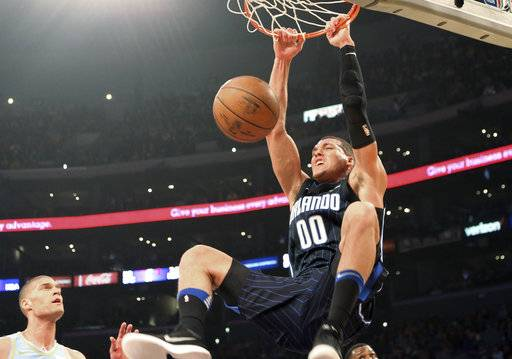 Orlando Magic guard Aaron Gordon dunks against the Los Angeles Lakers during the first half of an NBA basketball game in Los Angeles on Wednesday, March 7, 2018.