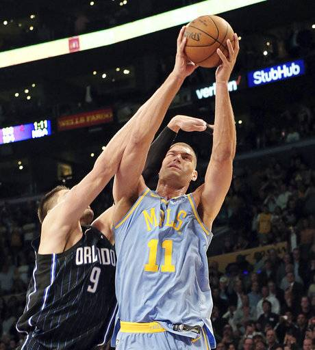 Orlando Magic center Nikola Vucevic (9 fouls Los Angeles Lakers' Brook Lopez (11) in the final seconds of an NBA basketball game in Los Angeles on Wednesday, March 7, 2018. Lopez made the two free throws, putting the Lakers ahead. The Lakers won 108-107.