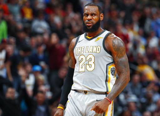 Cleveland Cavaliers forward LeBron James reacts after hitting a 3-point basket against the Denver Nuggets late in the second half of an NBA basketball game Wednesday, March 7, 2018, in Denver. The Cavaliers won 113-108.