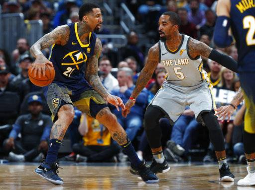 Denver Nuggets forward Wilson Chandler, left, looks to drive to the basket as Cleveland Cavaliers guard JR Smith defends during the first half of an NBA basketball game Wednesday, March 7, 2018, in Denver.