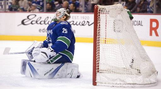 Vancouver Canucks goaltender Jacob Markstrom reacts after giving up a goal to Arizona Coyotes center Clayton Keller during the first period of an NHL hockey game Wednesday, March 7, 2018, in Vancouver, British Columbia. (Jonathan Hayward/The Canadian Press via AP)