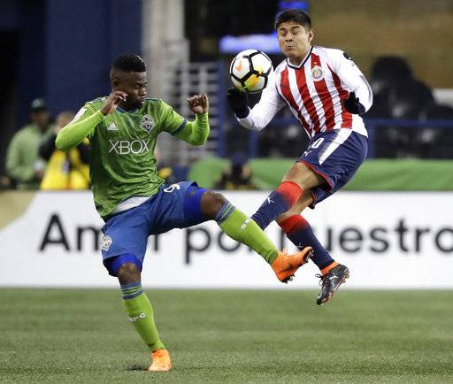 Seattle Sounders defender Waylon Francis, left, and Guadalajara midfielder Javier Lopez, right, vie for the ball during the first half of a CONCACAF Champions League soccer match Wednesday, March 7, 2018, in Seattle.