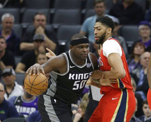 New Orleans Pelicans forward Anthony Davis, right, tries to stop Sacramento Kings forward Zach Randolph, left, during the first quarter of an NBA basketball game Wednesday, March 7, 2018, in Sacramento, Calif.