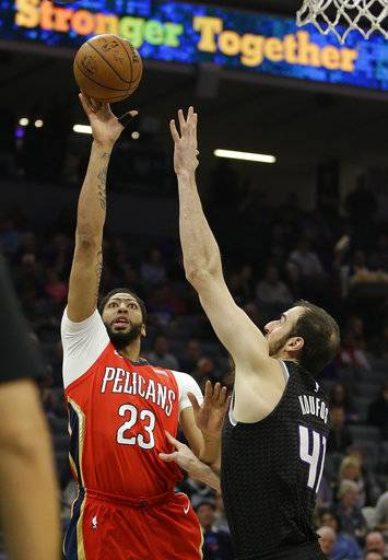 New Orleans Pelicans forward Anthony Davis, left, shoots over Sacramento Kings center Kosta Koufos during the first quarter of an NBA basketball game Wednesday, March 7, 2018, in Sacramento, Calif.