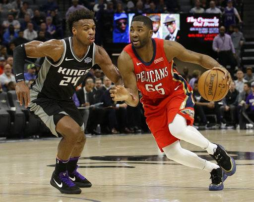 New Orleans Pelicans forward E'Twaun Moore, right, drives against Sacramento Kings guard Buddy Hield during the second quarter of an NBA basketball game Wednesday, March 7, 2018, in Sacramento, Calif.