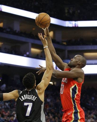 New Orleans Pelicans center Emeka Okafor, right, shoots over Sacramento Kings forward Skal Labissiere during the first quarter of an NBA basketball game Wednesday, March 7, 2018, in Sacramento, Calif.