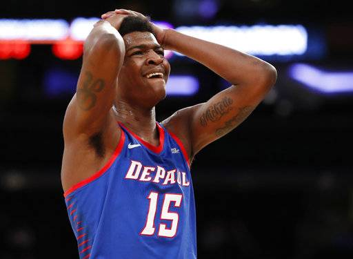 DePaul forward Paul Reed (15) reacts after drawing a foul for interrupting a three-point shot by Marquette during the first half of an NCAA college basketball game in the first round of the Big East conference tournament, in New York, Wednesday, March, 7, 2018.