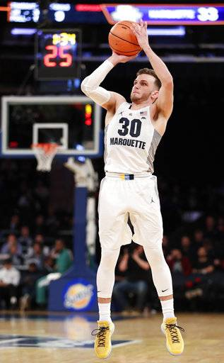 Marquette guard Andrew Rowsey (30) shoots a three-point shot during the first half of an NCAA college basketball game in the first round of the Big East conference tournament, in New York, Wednesday, March, 7, 2018.