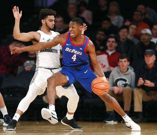 DePaul guard Brandon Cyrus (4) drives up against Marquette guard Markus Howard, left, during the first half of an NCAA college basketball game in the first round of the Big East conference tournament, in New York, Wednesday, March, 7, 2018.