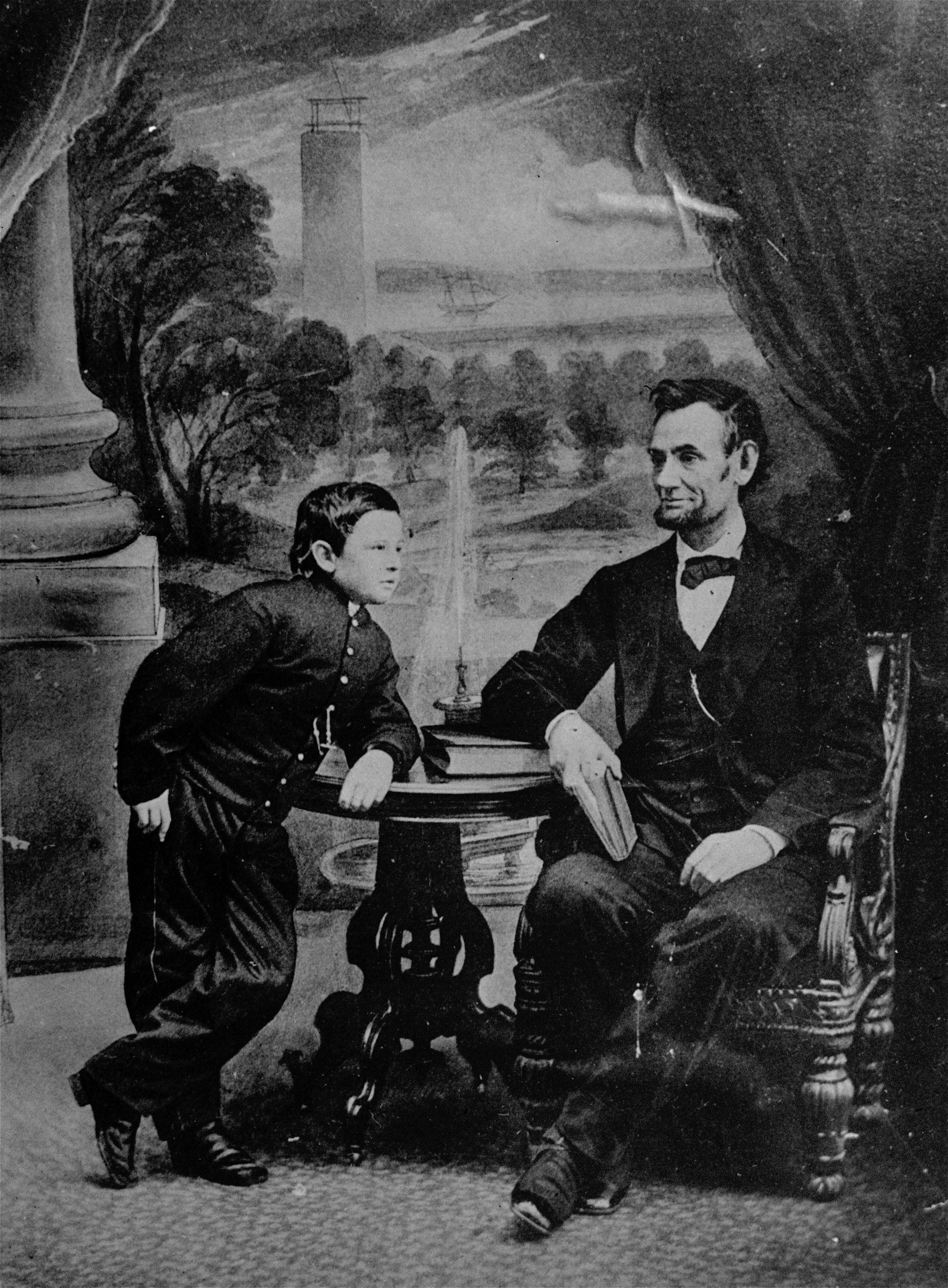 President Abraham Lincoln poses with his son, Tad.