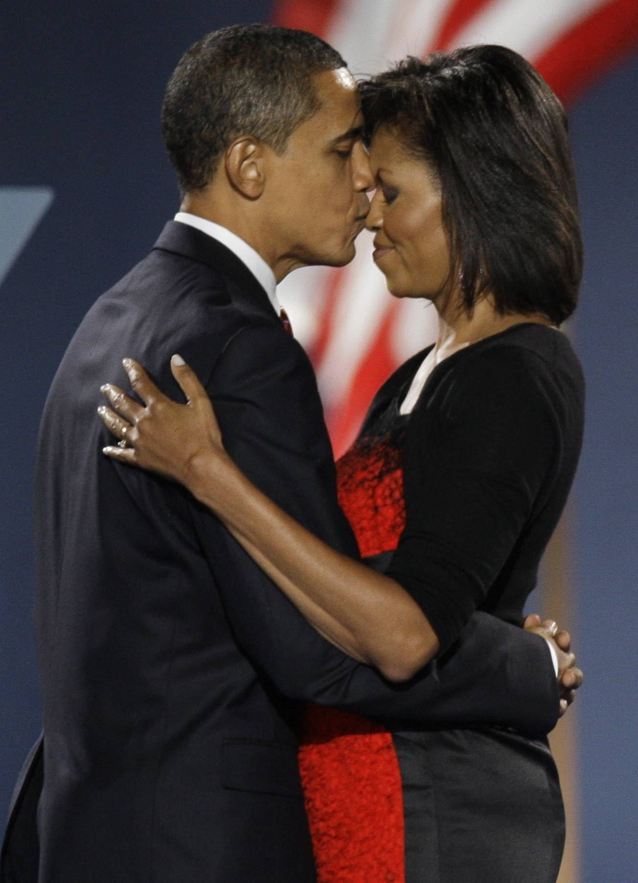 President-elect Barack Obama kisses his wife, Michelle, at his 2008 Election Night party at Grant Park in Chicago.