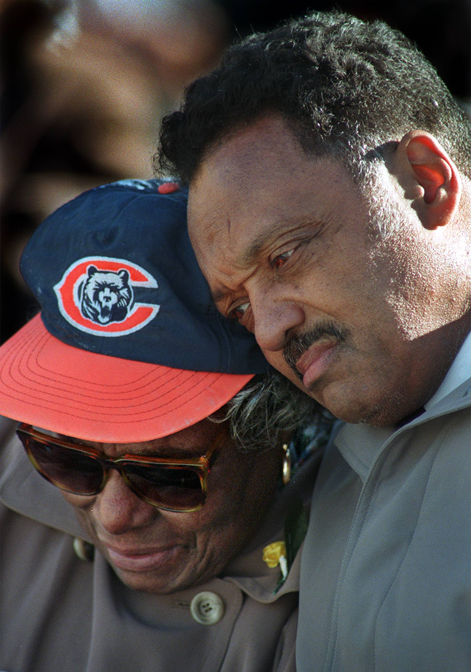 The Rev. Jesse Jackson comforts Alyne Payton at a 1999 memorial service for her son, Chicago Bears great Walter Payton.