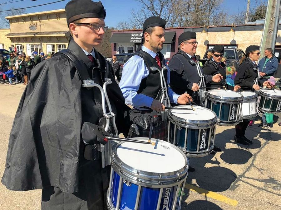 Drummers with the Chicago Celtic Pipe Band play during East Dundee's St. Patrick's Day festivities Saturday. The parade also featured Olympian Bradie Tennell of Carpentersville, who rode in on a fire truck with Carpentersville firefighters.