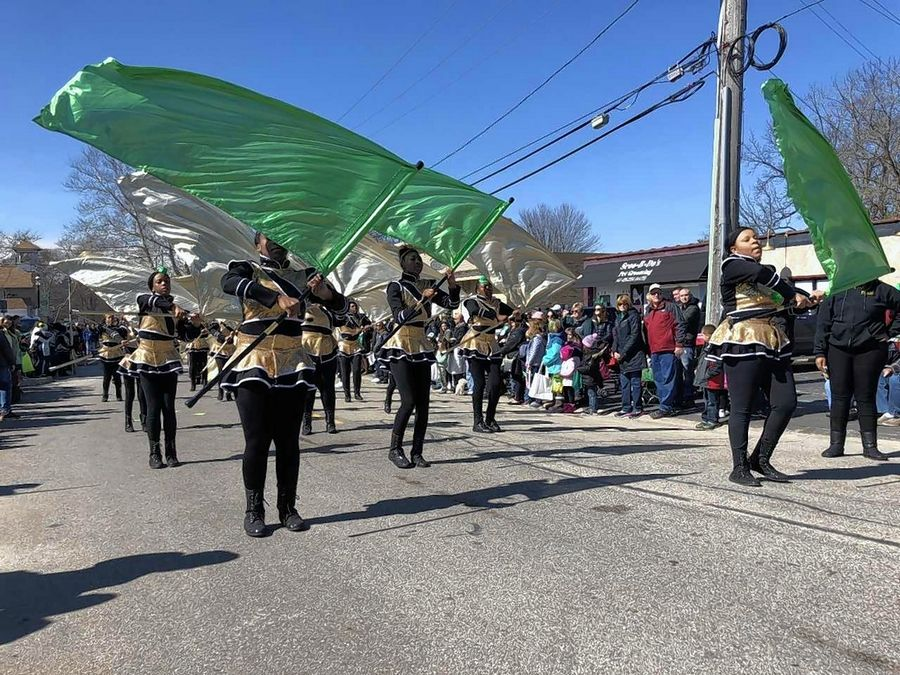 Members of the South Shore Drill Team show off their flag twirling skills Saturday during East Dundee's St. Patrick's Day festivities.
