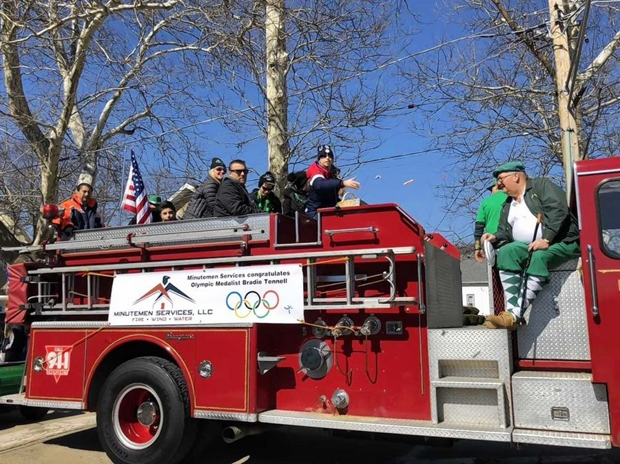 Olympic bronze medalist Bradie Tennell of Carpentersville rides a fire truck along with family and friends Saturday during the Thom McNamee Memorial St. Patrick's Day Parade in East Dundee.