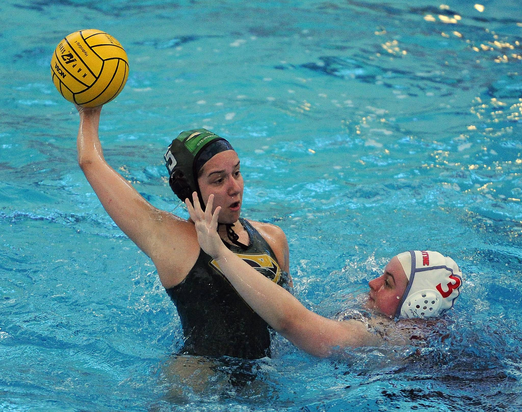 Stevenson's Kalista Tapas fires a shot over Palatine's Kiki Herbst in the girls water polo tournament play at Stevenson on Saturday. Stevenson defeated Palatine 15-0.