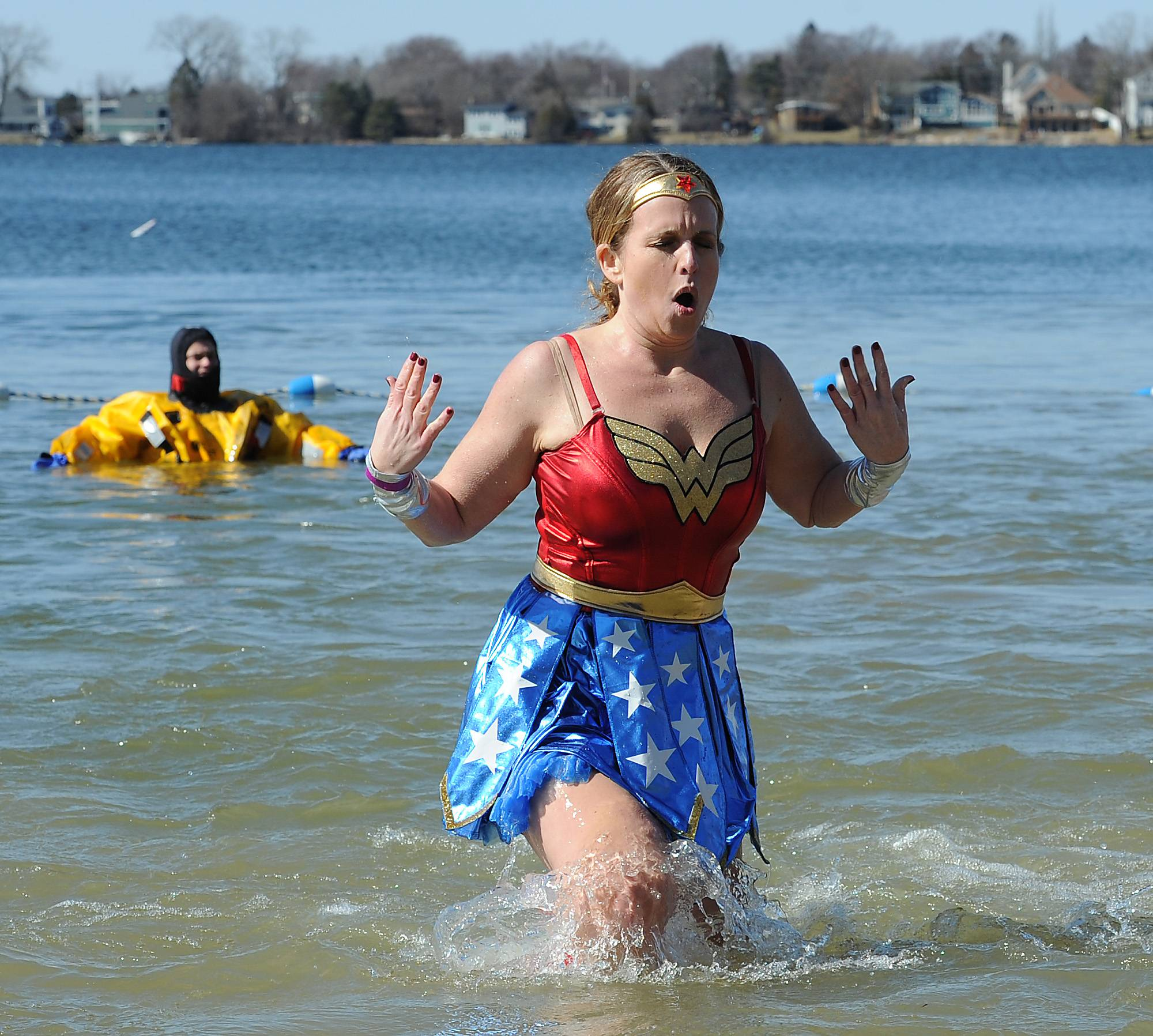 Tracy Fitzgerald, 42, of Schaumburg dressed as Wonder Woman, was not feeling so wonderful after she plunged into the cold water at Breezewald Beach to support cancer survivors.