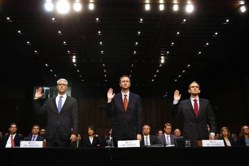 FILE - In this Nov. 1, 2017, file photo, from left, Facebook General Counsel Colin Stretch, Twitter Acting General Counsel Sean Edgett and Google Senior Vice President and General Counsel Kent Walker are sworn in for a Senate Intelligence Committee hearing on Russian election activity and technology, on Capitol Hill in Washington. Much of what happens in political campaigns today takes place in the often murky world of social media, where the sources of ads do not have to be disclosed and hoaxes spread quickly. The 2016 presidential race featured Russian interference that included covert ads on social media and phony Facebook groups pumping out falsehoods.