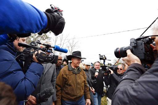 FILE - In this Tuesday, Dec. 12, 2017, file photo, journalists follow U.S. Senate candidate Roy Moore as he arrives to cast his vote in Gallant, Ala. December's U.S. Senate election in Alabama was rife with fake online reports in support of Moore, who lost the race to Democrat Doug Jones amid allegations that Moore had sexual and romantic contact with teens when he was a prosecutor in his 30s.