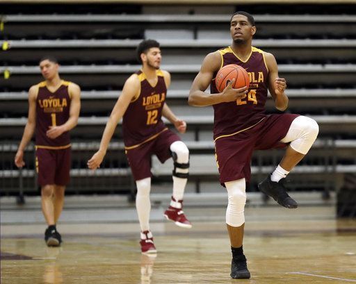 Loyola forward Aundre Jackson, right, warms up with teammates during NCAA college basketball practice in Chicago, Friday, March 9, 2018. Loyola locks up 1st March Madness appearance in 33 years.
