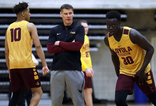 Loyola head coach Porter Moser, center, looks to his team during NCAA college basketball practice in Chicago, Friday, March 9, 2018. Loyola locks up 1st March Madness appearance in 33 years.