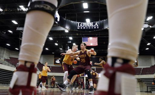 Loyola center Cameron Krutwig, right, works with forward Nick DiNardi during NCAA college basketball practice in Chicago, Friday, March 9, 2018. Loyola locks up 1st March Madness appearance in 33 years.