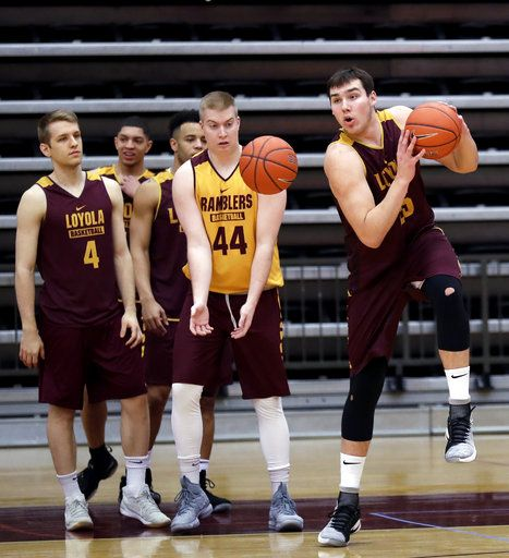 Loyola center Cameron Krutwig, right, forward Nick DiNardi (44) and guard Bruno Skokna (4) work with teammates during NCAA college basketball practice in Chicago, Friday, March 9, 2018. Loyola locks up 1st March Madness appearance in 33 years.