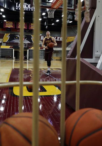 Loyola center Cameron Krutwig looks to the basket during NCAA college basketball practice in Chicago, Friday, March 9, 2018. Loyola locks up 1st March Madness appearance in 33 years.