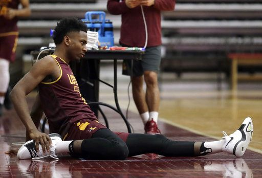Loyola guard Donte Ingram stretches during NCAA college basketball practice in Chicago, Friday, March 9, 2018. Loyola locks up 1st March Madness appearance in 33 years.