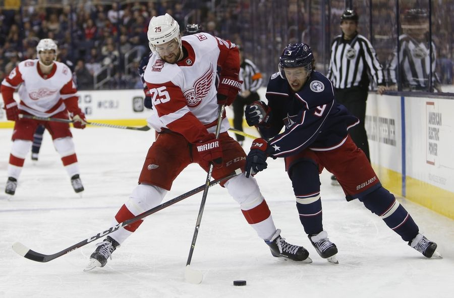 The Detroit Red Wings' Mike Green, here at left battling Columbus' Artemi Panarin for the puck, might end up being the biggest name on the free-agent market this off-season.