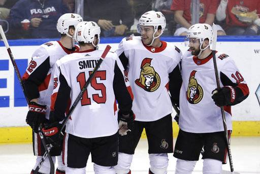 Ottawa Senators' Magnus Paajarvi, second from right, celebrates his goal with Zack Smith (15) and Tom Pyatt (10) during the third period of an NHL hockey game against the Florida Panthers, Monday, March 12, 2018, in Sunrise, Fla.