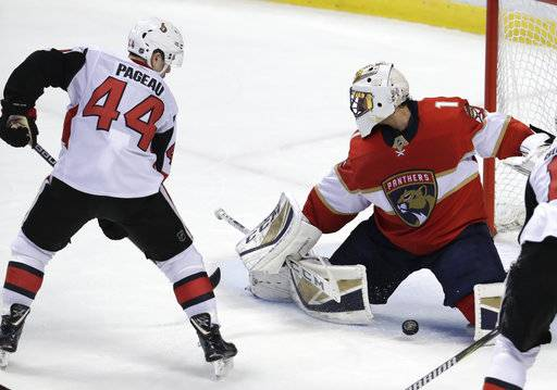 Ottawa Senators' Jean-Gabriel Pageau (44) scores a goal past Florida Panthers goaltender Roberto Luongo (1) during the third period of an NHL hockey game, Monday, March 12, 2018, in Sunrise, Fla.