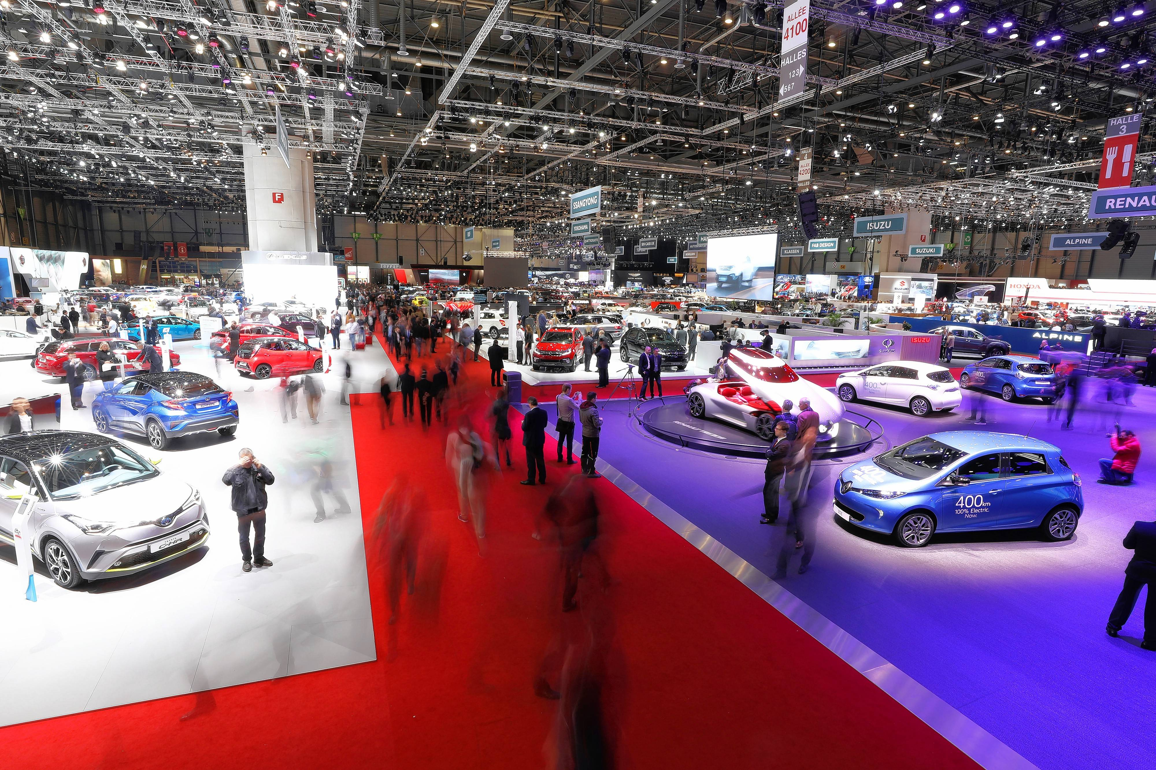 Automobiles stand on display in an exhibition hall at the 2017 Geneva International Motor Show in Geneva, Switzerland.