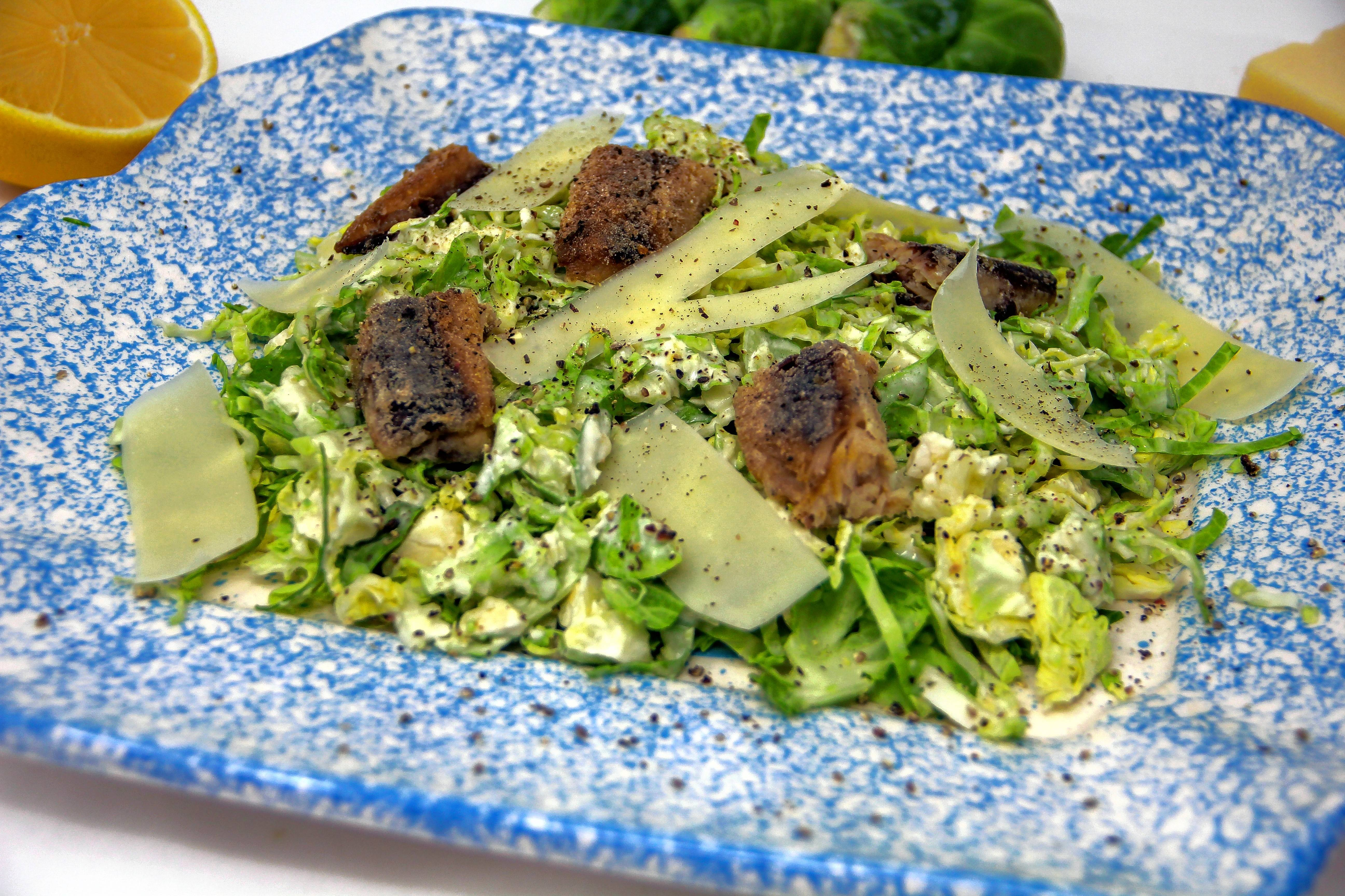 Brussels sprouts Caesar salad uses Brussels sprouts instead of romaine, a little mayo instead of raw egg, sardines as croutons and no anchovy paste.