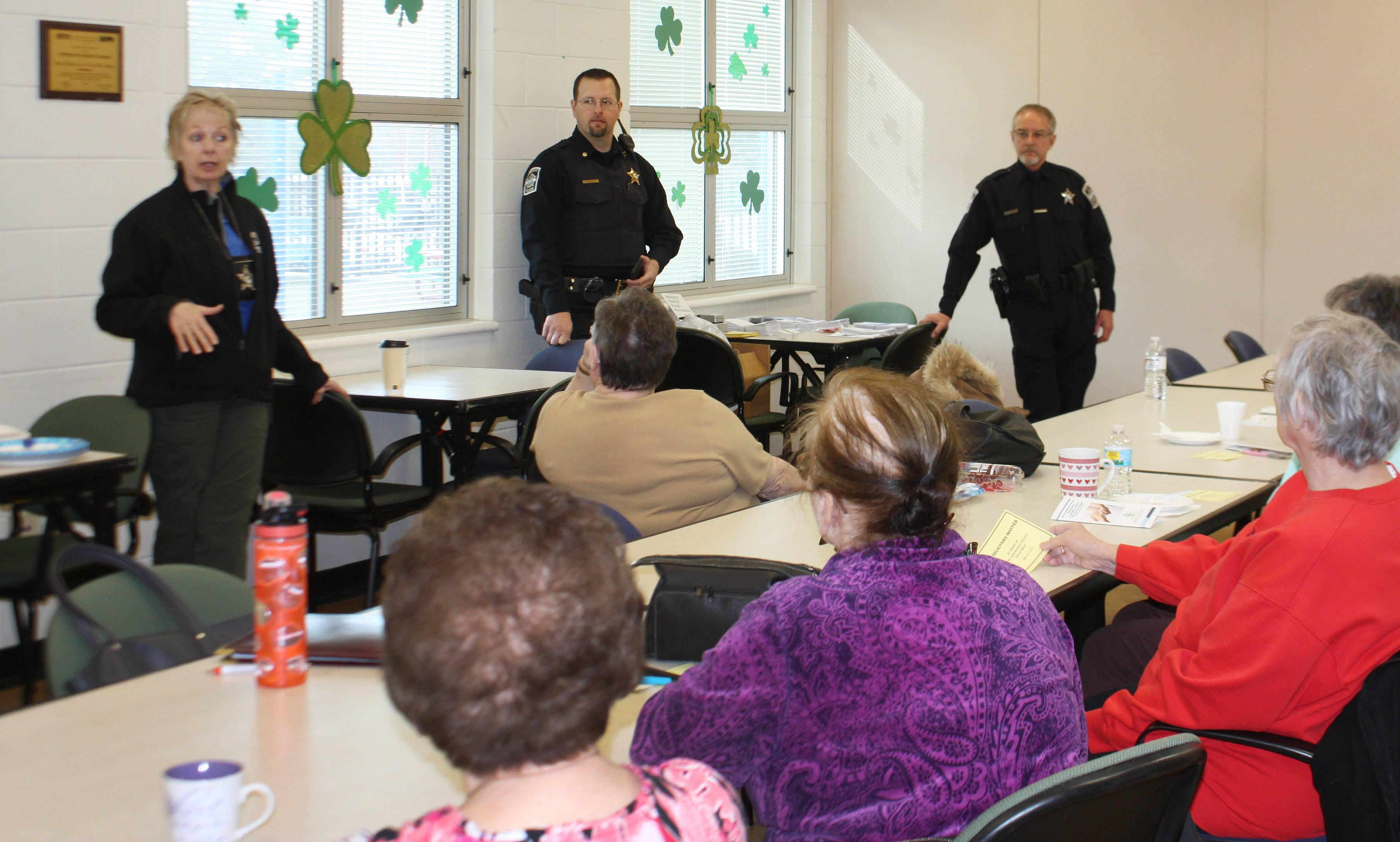 Lindenhurst police officer Sandy Rapey, left, Cmdr. Eric Senica and officer Mike Kirkpatrick speak to seniors at the Lindenhurst Park District about a new program called Elderly Residents in Need.