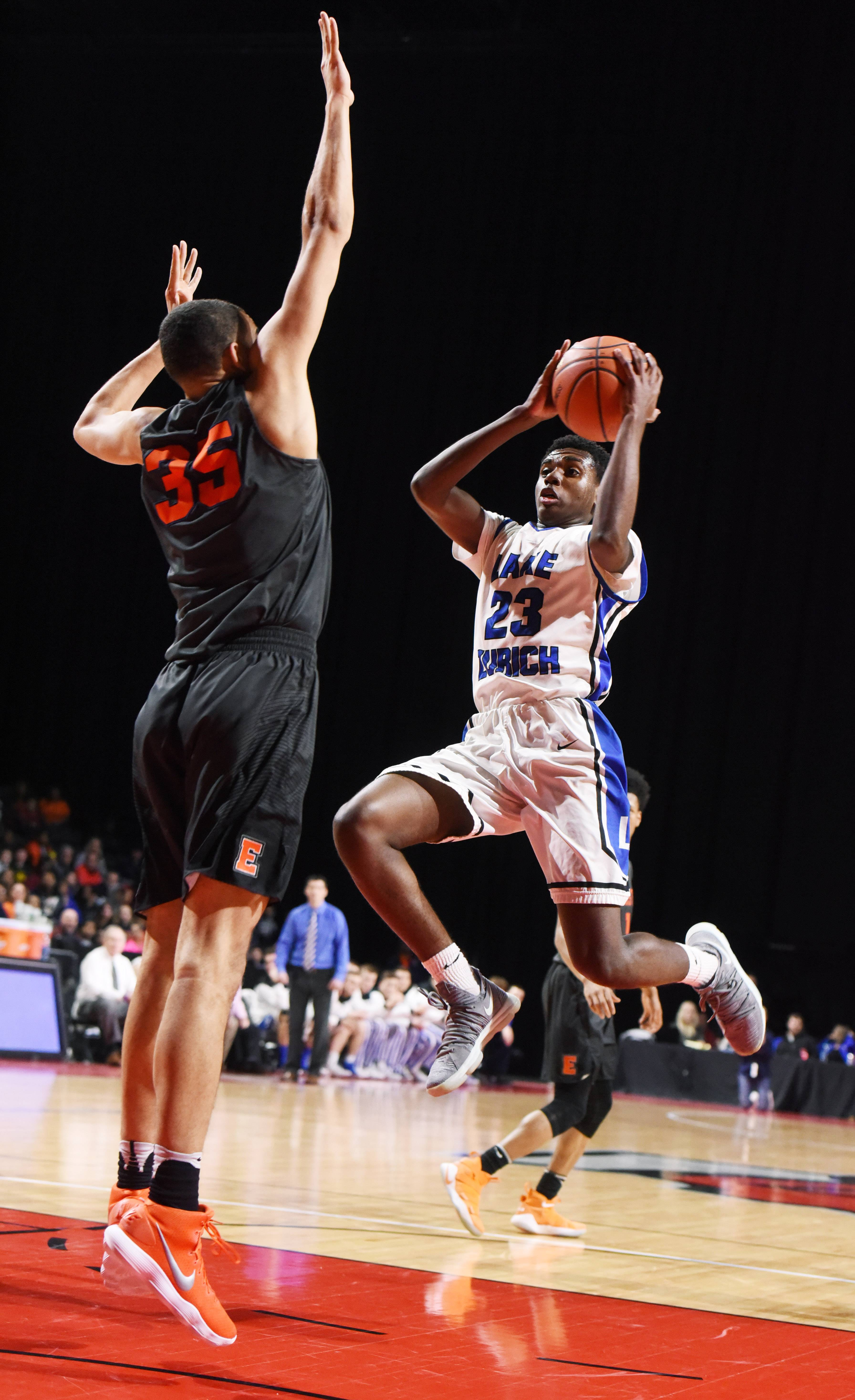 Lake Zurich's Kenny Haynes makes a move toward the basket against Evanston's Matt Hall during the Class 4A supersectional at the Sears Centre in Hoffman Estates Tuesday.