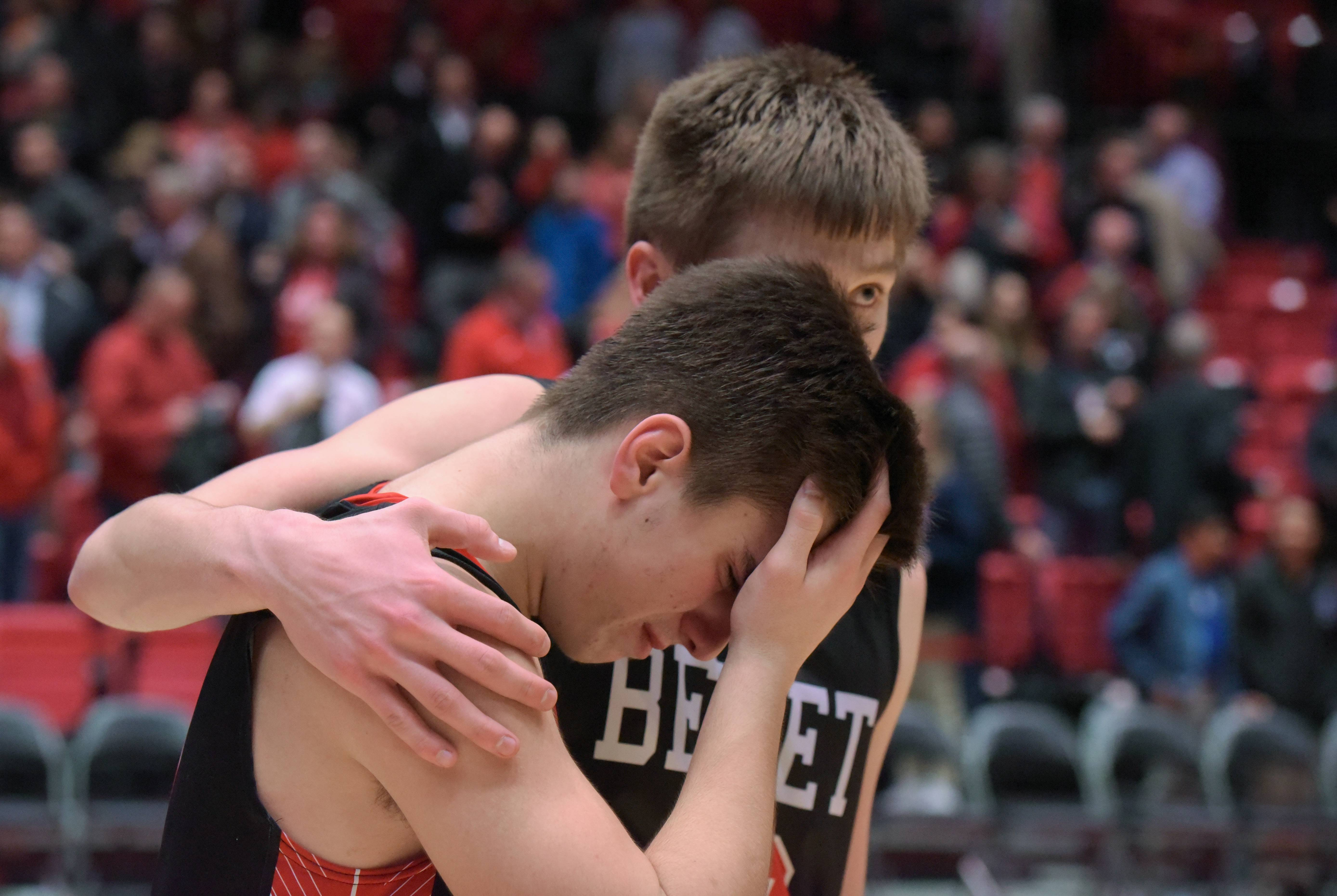 Benet's Jacob Petrovic (4) and Benet's David Buh (12) react their 53-46 loss to Larkin during the boys basketball 4A super-sectional at the Convocation Center in DeKalb on Tuesday, March 13, 2018.