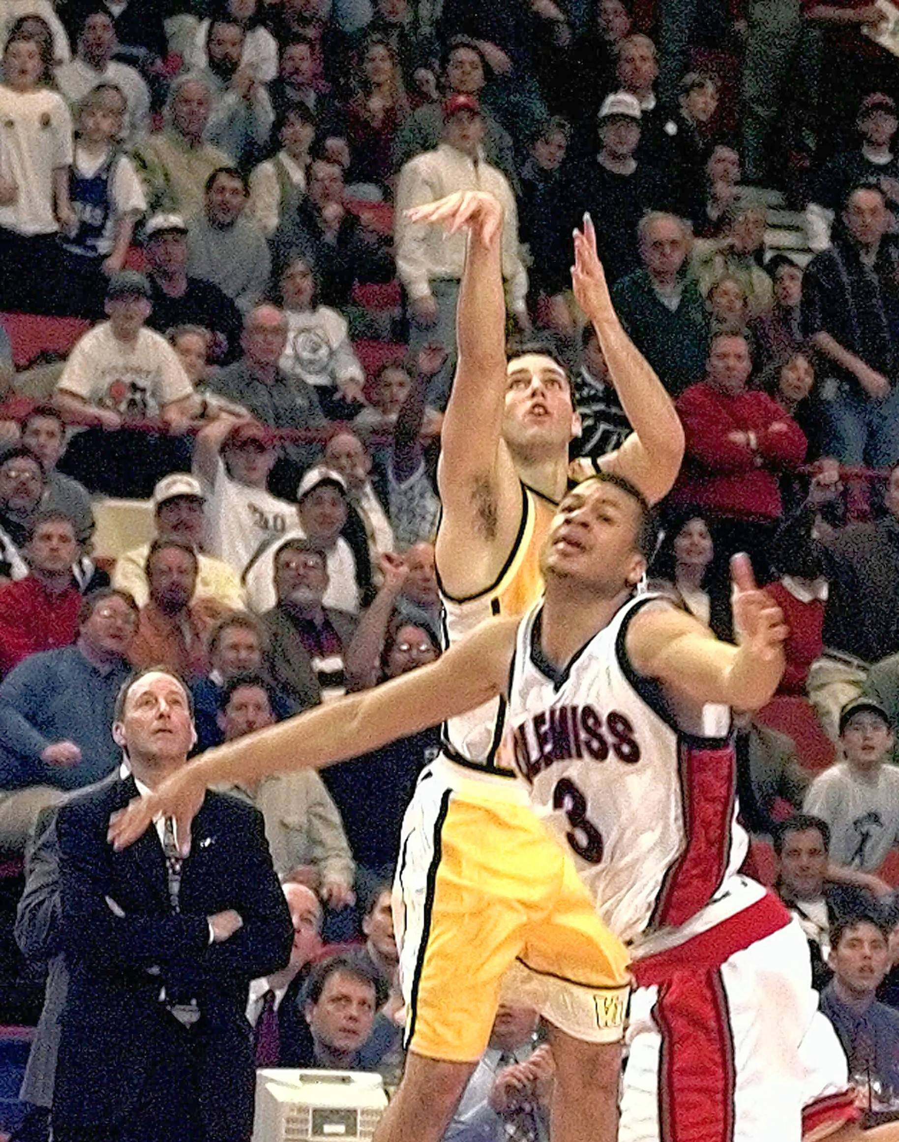 Valparaiso's Bryce Drew, shown here with his game-winning three-point shot at the buzzer against Mississippi in the NCAA game 20 years ago, says he initially thought it would come up short. So did his father, coach Homer Drew watching at left.