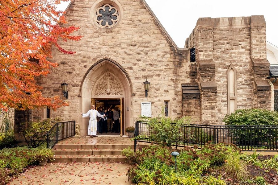 "The Rev. George Smith welcomes parishioners to St. Mark's Episcopal Church in Glen Ellyn, which recently was recognized as an ""awesome"" church by New York's Teen Vogue."