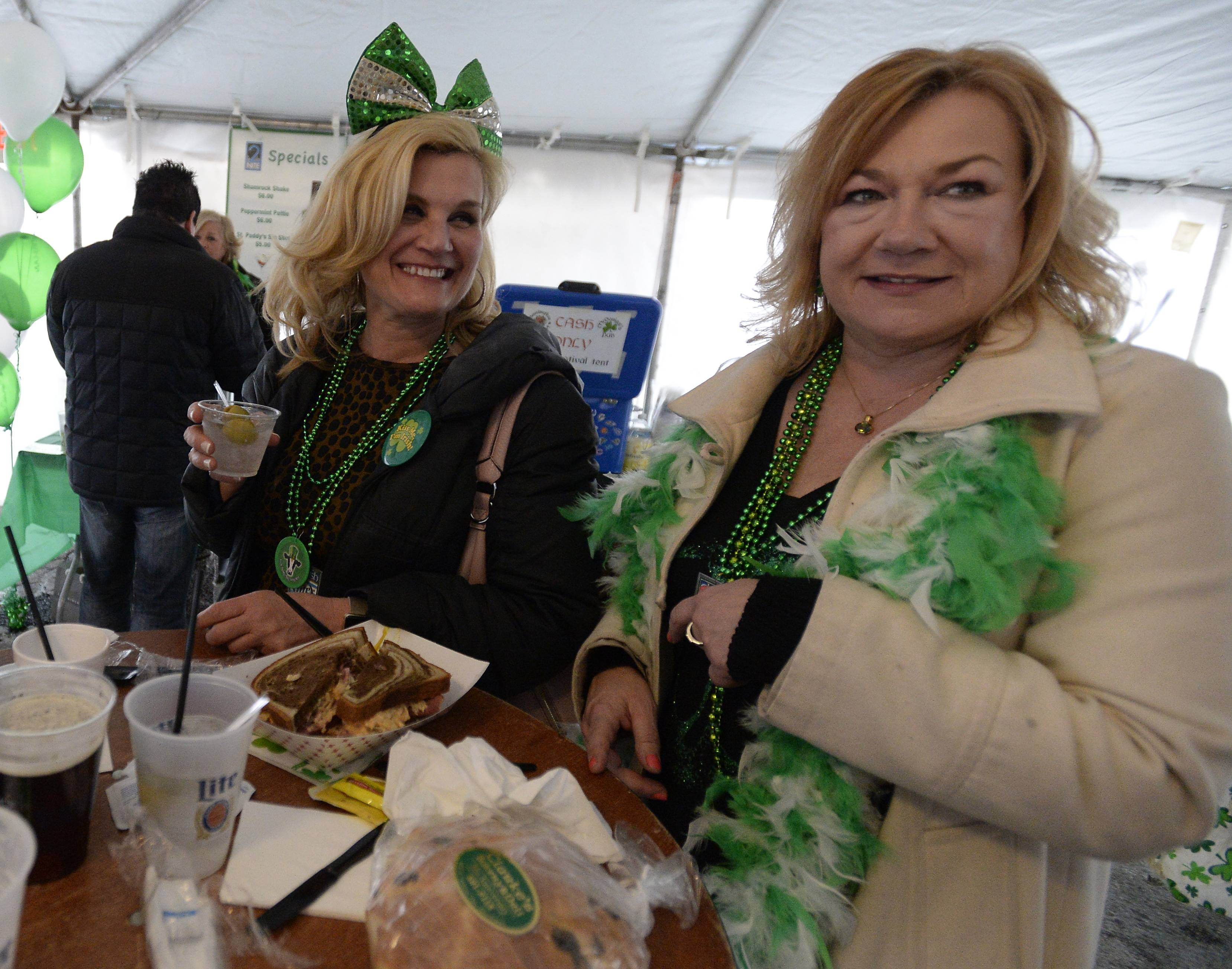 Annette dePaola of Barrington, left, and Tara McNally of Glendale Heights donned their Irish green while sampling beer and corn beef sandwiches during Barrington Celtic Fest last year. The eighth annual edition of the fest is set for this weekend in downtown Barrington.