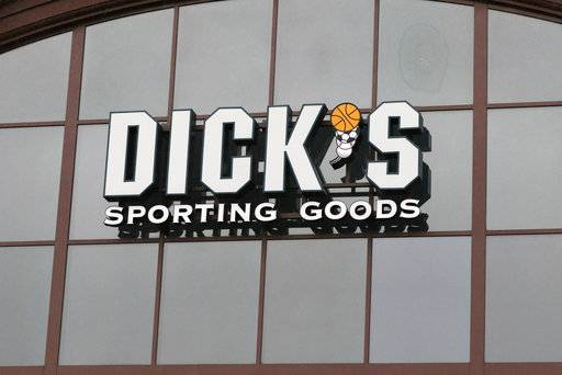 FILE- In this March 1, 2018, file photo, a sign for Dick's Sporting Goods store is displayed at the store in Madison, Miss. Dick's Sporting Goods, Inc. reports earnings Tuesday, March 13, 2018. (AP Photo/Rogelio V. Solis, File)