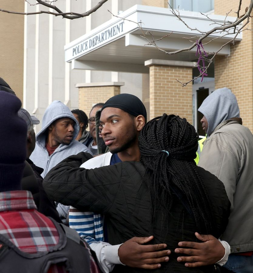 Tyri Clements receives an embrace as a rally was held in front of the Elgin Police Department Tuesday in the wake of Monday's police-involved shooting death of Decynthia Clements.