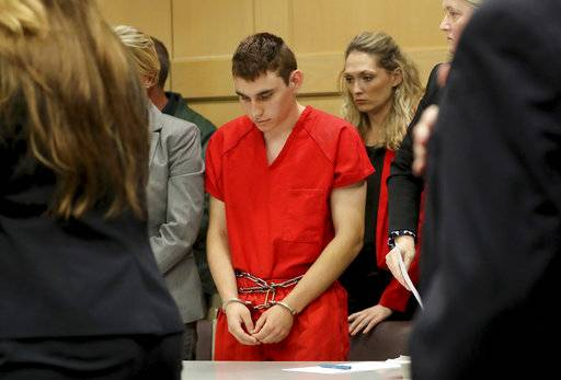 FILE- This Feb. 19, 2018 file photo shows Nikolas Cruz appearing in court for a status hearing before Broward Circuit Judge Elizabeth Scherer in Fort Lauderdale, Fla., Florida prosecutors announced Tuesday, March 13 that they will seek the death penalty against Cruz, a former student charged in the fatal shooting of 17 people at Marjory Stoneman Douglas High School last month. (Mike Stocker/South Florida Sun-Sentinel via AP, Pool, File)