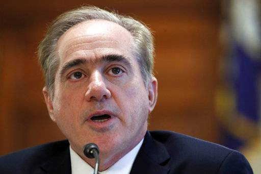 FILE - In this Feb. 6, 2018, file photo, Veterans Affairs Secretary David Shulkin speaks during a House Committee on Veterans' Affairs hearing on veteran caregiver support on Capitol Hill in Washington. Shulkin is hanging onto his job by a thread. He faces an insurgency from within his department and new allegations that he had a member of his security detail go shopping with him at Home Depot and then cart the purchases into his house. (AP Photo/Jacquelyn Martin, File)
