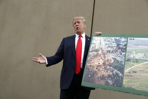 President Donald Trump speaks during a tour as he reviews border wall prototypes, Tuesday, March 13, 2018, in San Diego.