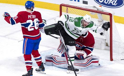 Dallas Stars center Radek Faksa (12) celebrates his goal past Montreal Canadiens goaltender Antti Niemi (37) as defenseman Jeff Petry (26) looks on during the first period of an NHL hockey game, Tuesday, March 13, 2018, in Montreal. (Paul Chiasson/The Canadian Press via AP)